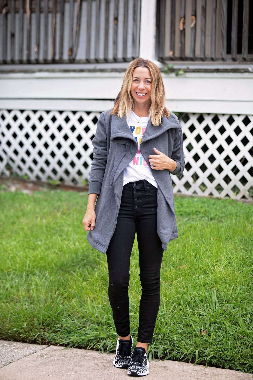 the motherchic wearing madewell black jeans adidas sneakers