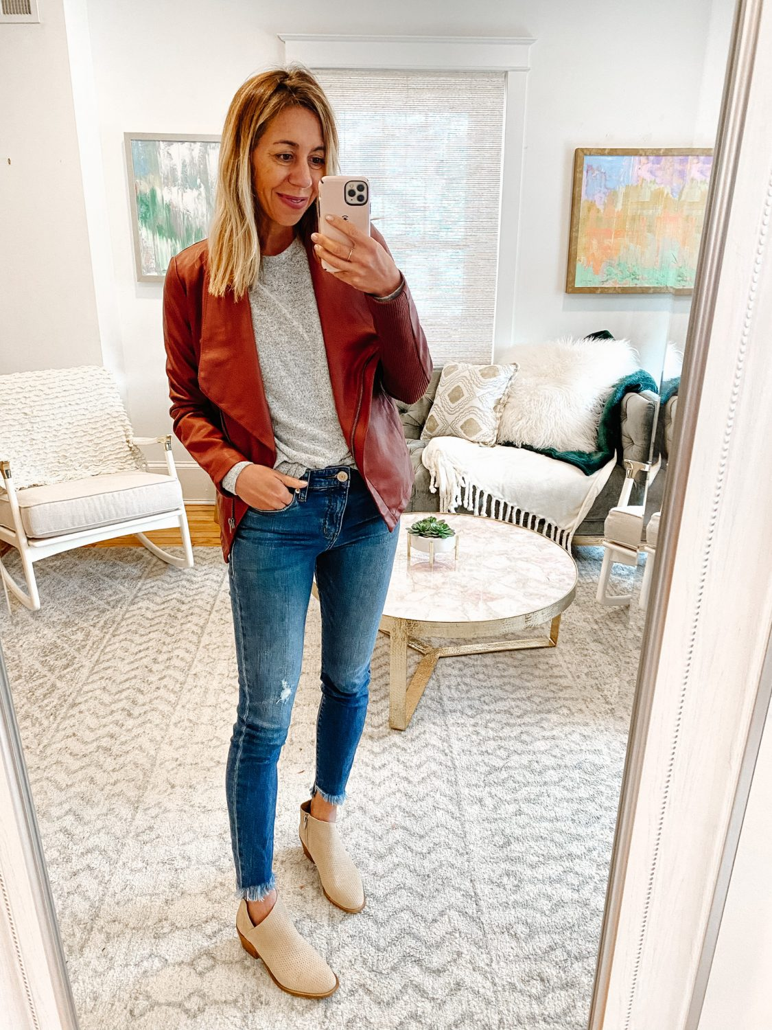 the motherchic wearing faux leather fall jacket