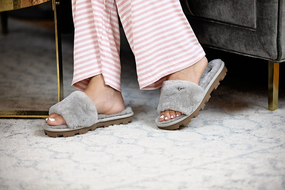 the motherchic wearing ugg slipper