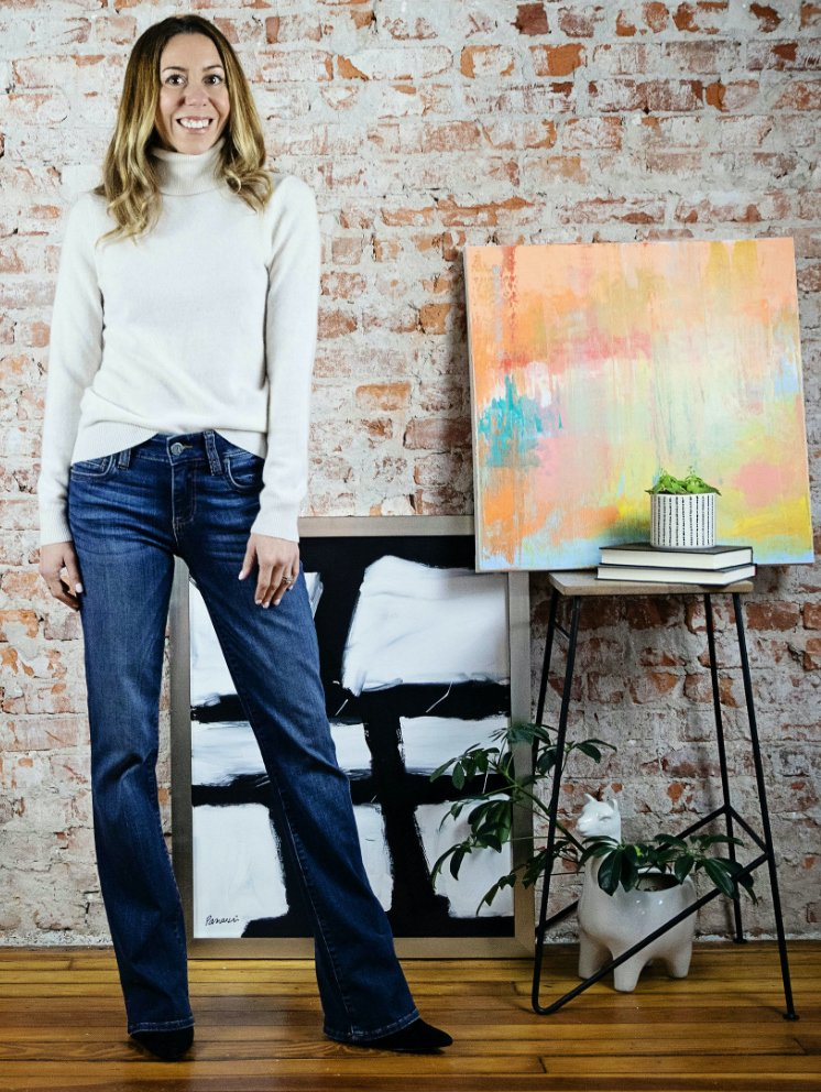 the motherchic wearing boot leg non-distressed jeans