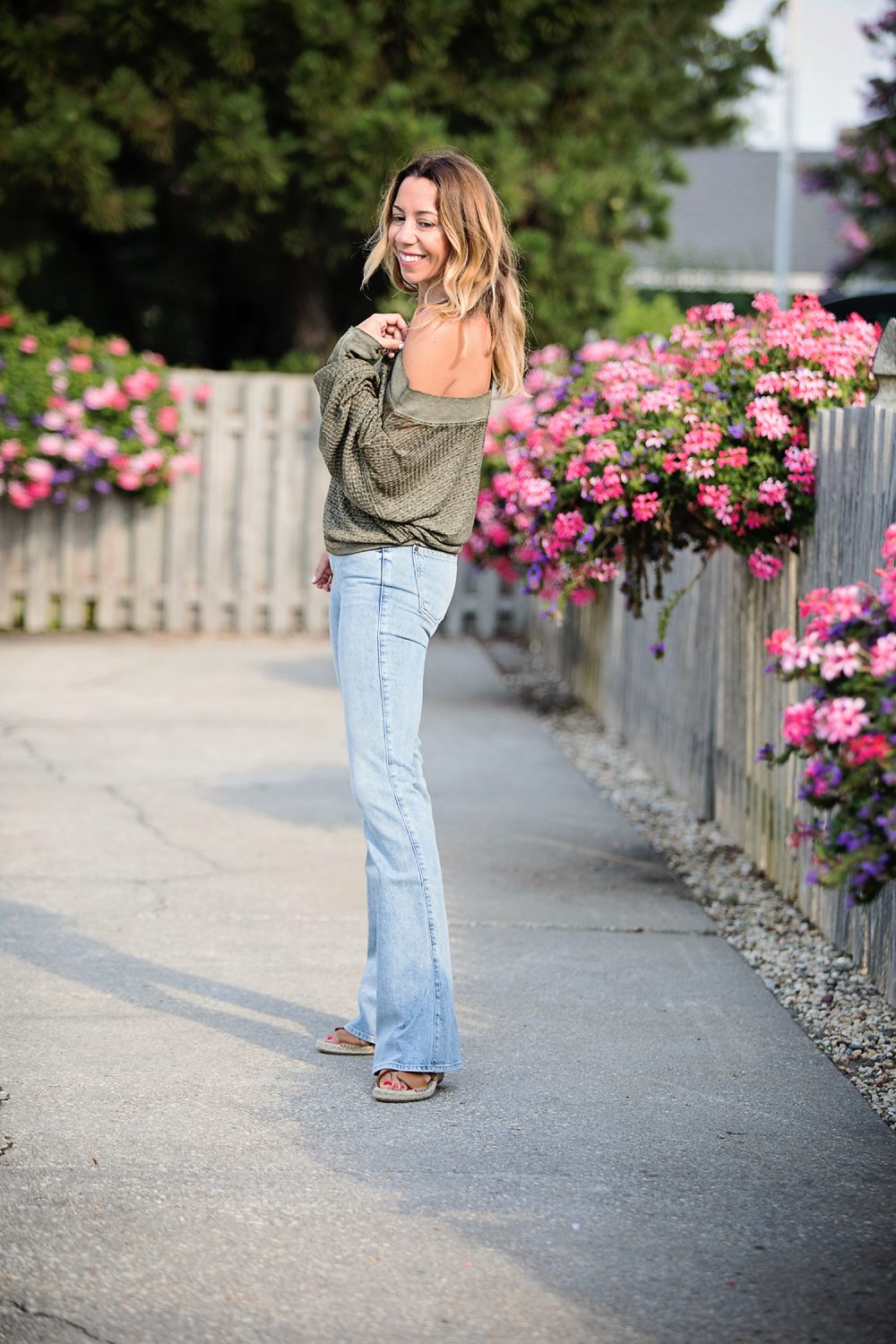 the motherchic wearing seven flare non-distressed jeans