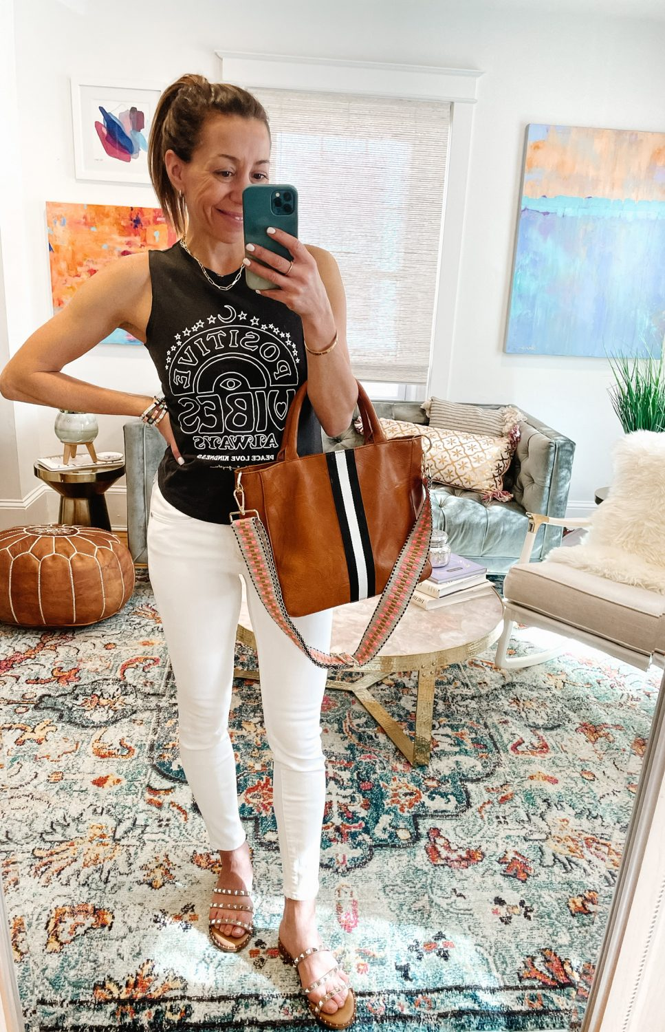the motherchic wearing levis white jeans