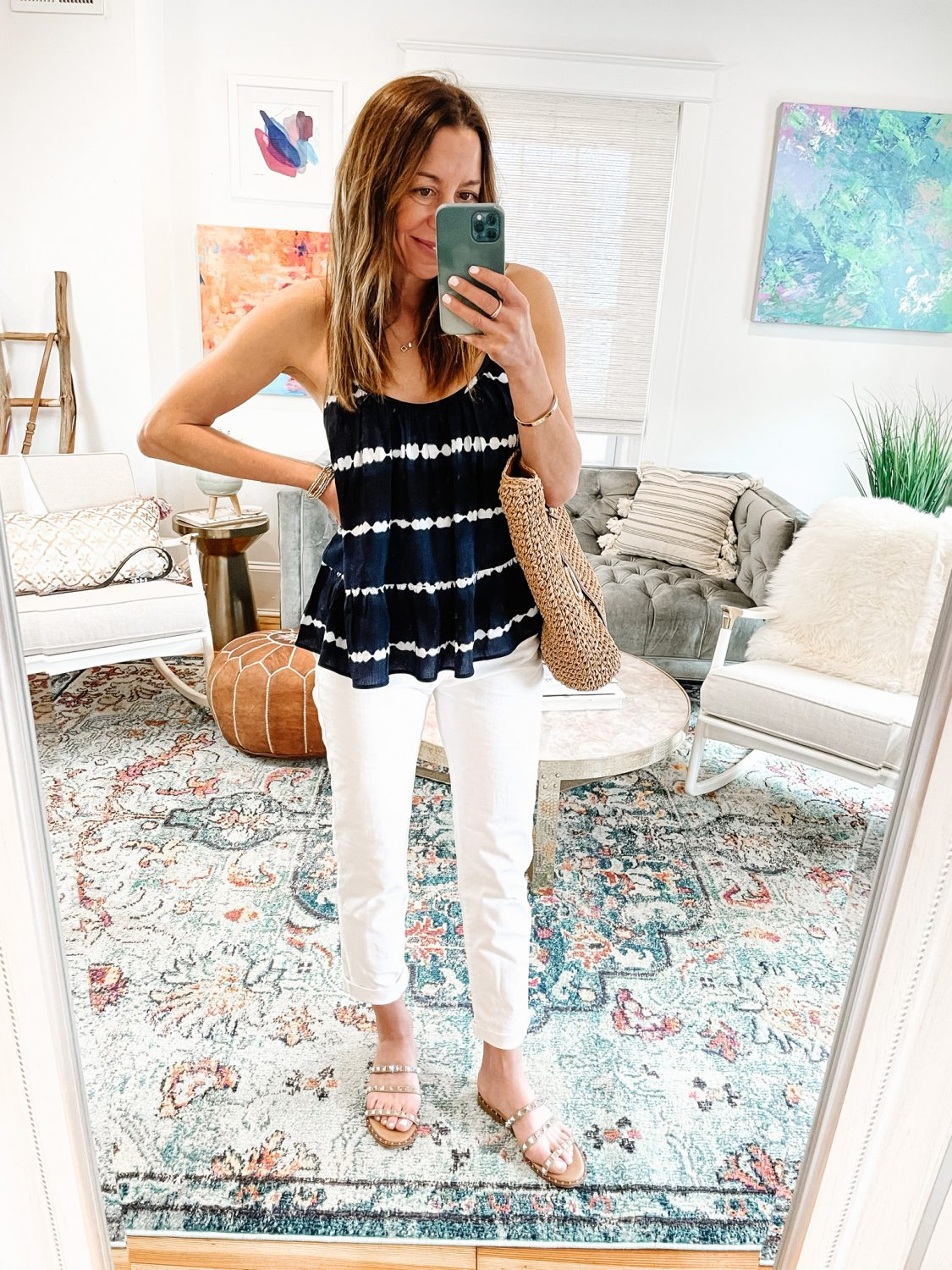 the motherchic wearing gap white jeans