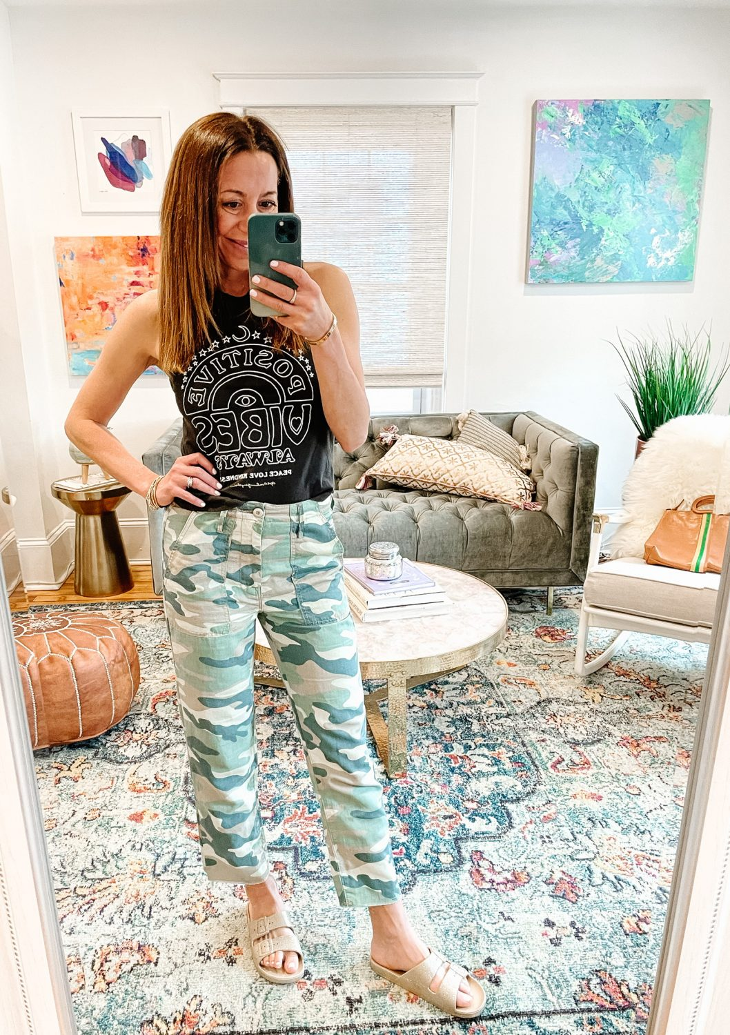 the motherchic wearing graphic tee and camo pants