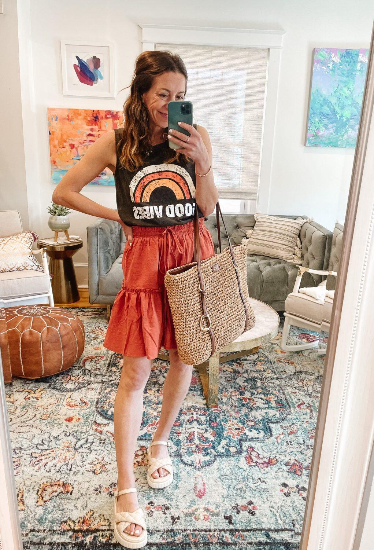 the motherchic wearing graphic tee good vibebs amazon skirt