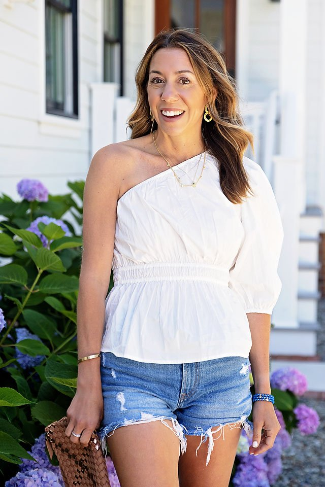 The Motherchic wearing going out tops