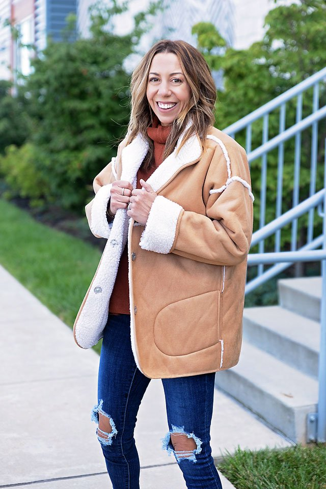 The motherchic wearing a fall jacket
